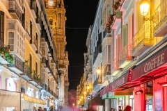 Old town street by night, Malaga, Andalusia, Spain