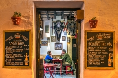 Tourists seated inside a typical Spanish restaurant, Arcos de la Frontera, Andalusia, Spain