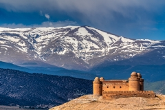 Calahorra castle with the Sierra Nevada mountain range in the background, La Calahorra, Andalusia, Spain