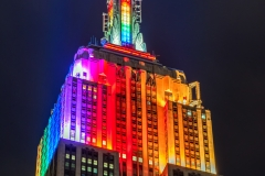 Empire State Building lit up with rainbow colors, Manhattan, New York, USA