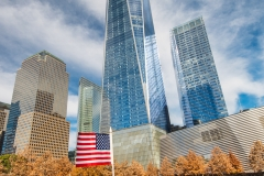 National September 11 Memorial & Museum with One World Trade Center or Freedom Tower behind, Lower Manhattan, New York, USA