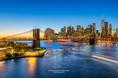 Brooklyn Bridge and Lower Manhattan skyline at dusk, New York, USA