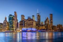 Lower Manhattan skyline and East River at dusk, New York, USA