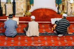 Men praying inside Hisar Camii or Fortress Mosque, Izmir, Turkey