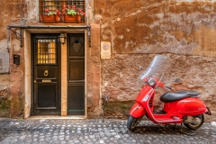 Parked red Vespa scooter in Rome, Lazio, Italy