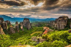 Sunset view over Monastery of Moni Agias Varvaras Roussanou and the spectacular massive rocky pinnacles of Meteora, Thessaly, Greece