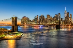 Brooklyn Bridge and Lower Manhattan skyline at dusk, Manhattan, New York, USA